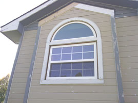 Coronet Window Company UNO single hung with colonial grids topped by a half round purchased from Home Depot.